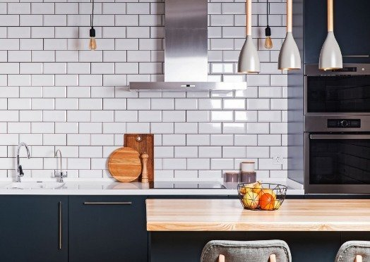 white tiles in a kitchen at Mitcham Tilers